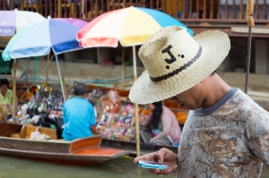Man using mobile phone abroad